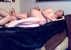 Couple having sex from behind lying down