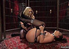 Brunette lesbian masturbates in cage