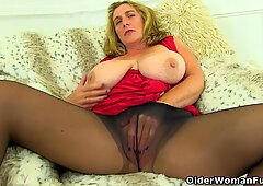 English milf Danielle will let you feast your eyes on her natural big tits