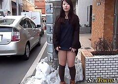 Asian lifts up her skirt