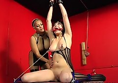 Brunette is tied up and spun by her blonde master