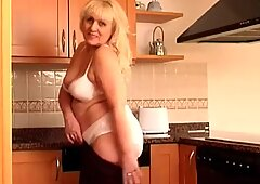 Chubby granny in size XXL panties strips off
