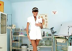 Nurse Angela masturbating with big dildo and speculum a