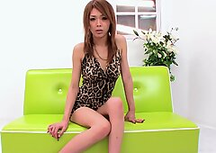 Super sexy babe in a leopard print dress bends over to show you her panties