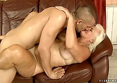 Judi slams her old shaved snatch down on thick dick