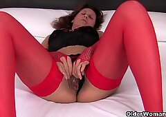 Hairy grandma in red stockings fingering full bushed pussy