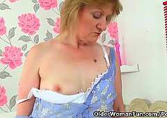 British grannie Clare cream lowers her pantyhose and plays