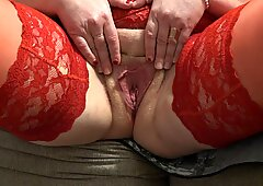 Do you want to be my virtual slave? Mature milf shows juicy holes, bbw in red stockings and in high-heeled shoes.