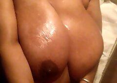Black Granny -Oiled up hugeg tits 2