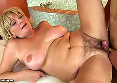 Hairy and very old grandma Sally G. is being pleased by a young cock