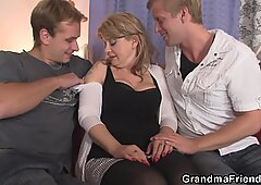 hot busty milf loves eating two cocks at once