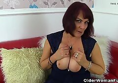 UK mummy Christina X rams her poon with a big black dildo