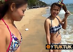 Two Thai cute whores found on the beach decide to please and satisfy a big white traveler s cock.