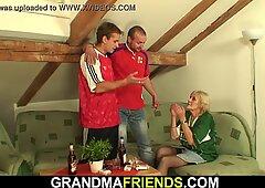 Skinny blonde granny in stockings rides and sucks