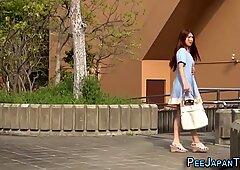 Asian ho pees beside car