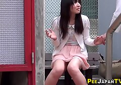 Asian teen pisses herself and soaks pants