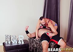 Bearded bear sits on cubs hard cock and rides it wildly